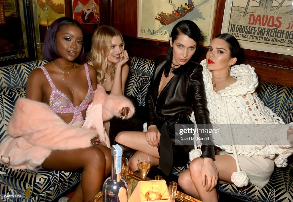 Justine Skye, Lily Donaldson, Bella Hadid and Kendall Jenner, wearing Burberry Feb 2017 Couture cape at the LOVE and Burberry London Fashion Week Party at Annabel's celebrating Katie Grand and Kendall Jenner's #LOVEME17 on February 20, 2017 in London, United Kingdom.