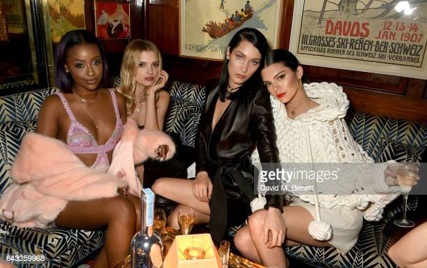 Justine Skye Lily Donaldson Bella Hadid and Kendall Jenner wearing Burberry Feb 2017 Couture cape at the LOVE and Burberry London Fashion Week Party...