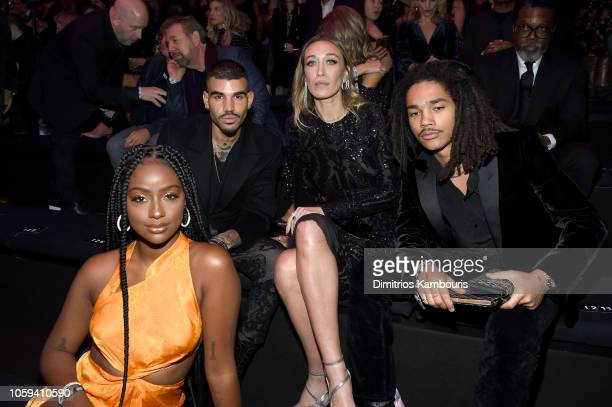 Justine Skye, Miles Richie, Alana Hadid, and Luka Sabbat attend the 2018 Victoria's Secret Fashion Show in New York at Pier 94 on November 8, 2018 in...