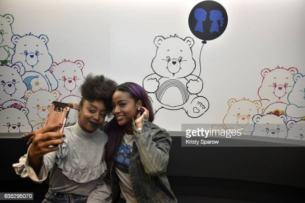 Justine Skye poses with a fan during the Boy Meets Girl x Care Bears Collection at Colette on February 14 2017 in Paris France
