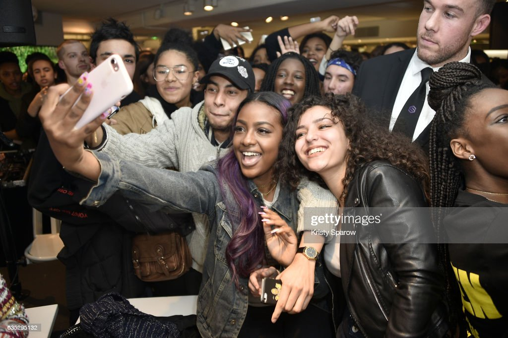 Justine Skye poses with fans during the Boy Meets Girl x Care Bears Collection at Colette on February 14, 2017 in Paris, France.