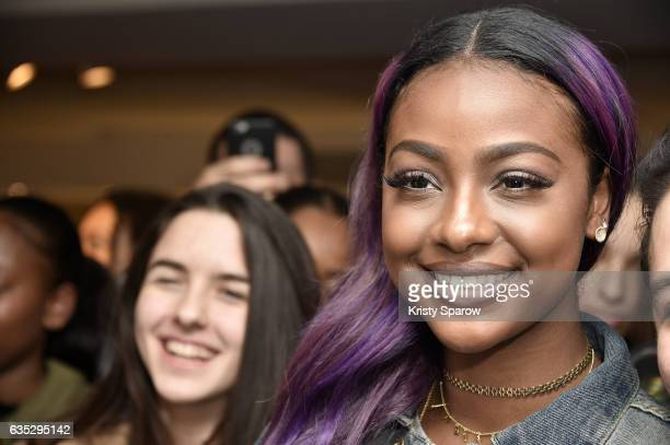 Justine Skye poses with fans during the Boy Meets Girl x Care Bears Collection at Colette on February 14 2017 in Paris France