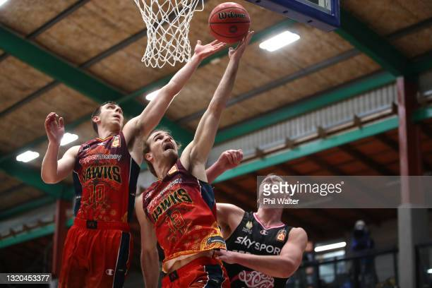 Justinian Jessup and Sam Froling of the Hawks take the rebound under pressure from Colton Iverson of the Breakers during the round 20 NBL match...