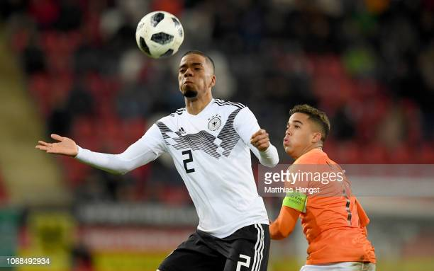 Justion Kluivert of Holland challenges Benjamin Henrichs of Germany during the International Friendly match between Germany U21 and Holland U21 at...