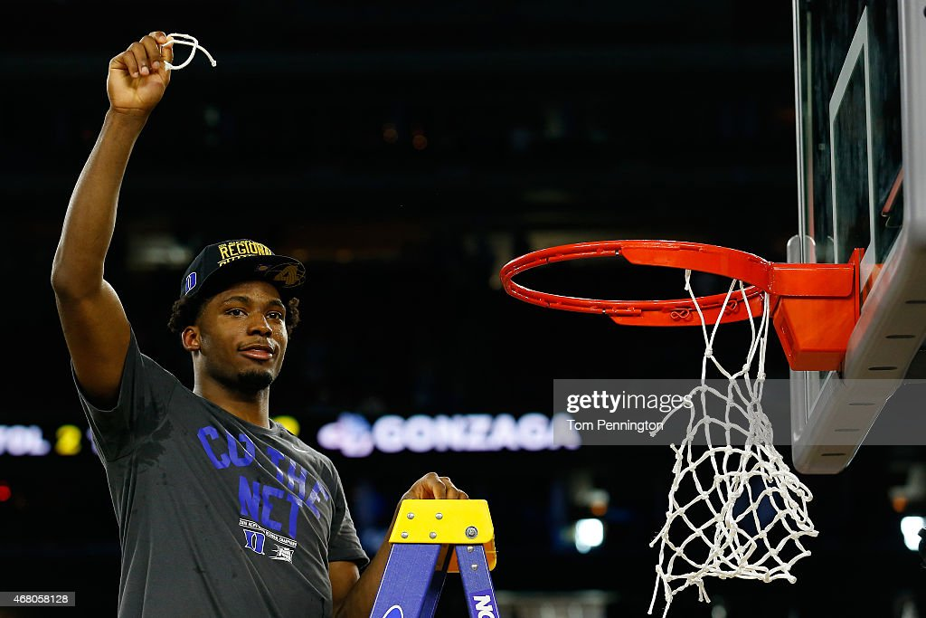 Justise Winslow #12 of the Duke Blue Devils cuts down the net after defeating the Gonzaga Bulldogs 66-52 in the South Regional Final of the 2015 NCAA Men's Basketball Tournament at NRG Stadium on March 29, 2015 in Houston, Texas.