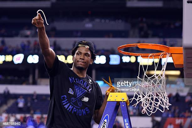 Justise Winslow of the Duke Blue Devils cuts down the net after defeating the Wisconsin Badgers during the NCAA Men's Final Four National...