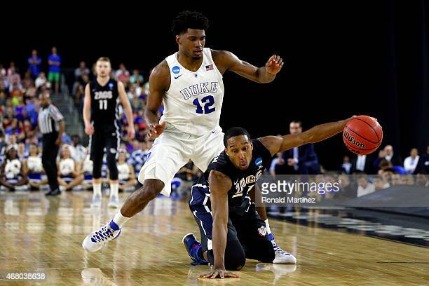 Justise Winslow of the Duke Blue Devils defends against Eric McClellan of the Gonzaga Bulldogs during the South Regional Final of the 2015 NCAA Men's...