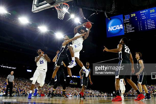 Justise Winslow of the Duke Blue Devils drives to the basket against Angel Nunez of the Gonzaga Bulldogs during the South Regional Final of the 2015...