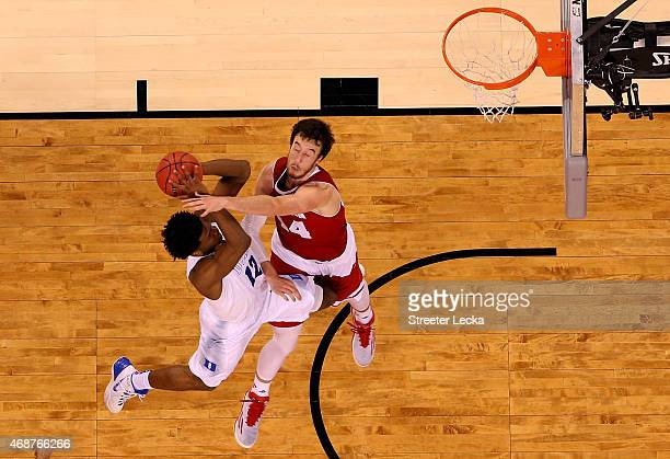 Justise Winslow of the Duke Blue Devils drives to the basket against Frank Kaminsky of the Wisconsin Badgers during the NCAA Men's Final Four...