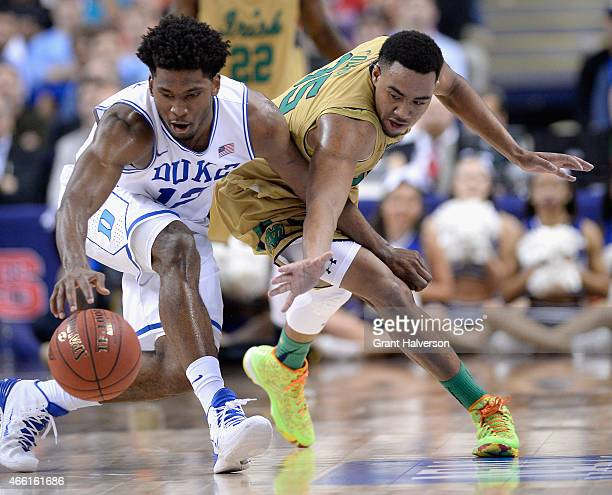 Justise Winslow of the Duke Blue Devils goes after a loose ball against Bonzie Colson of the Notre Dame Fighting Irish during the semifinals of the...