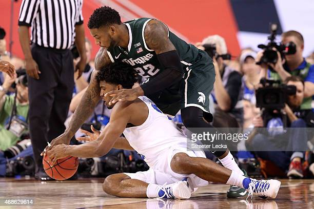 Justise Winslow of the Duke Blue Devils goes for a loose ball against Branden Dawson of the Michigan State Spartans in the second half during the...