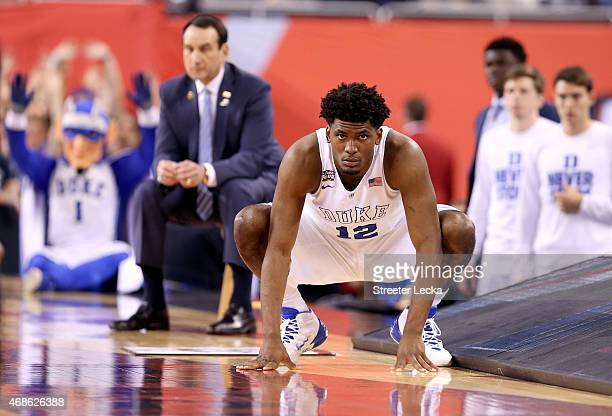 Justise Winslow of the Duke Blue Devils waits to enter the game in the first half as head coach Mike Krzyzewski looks on against the Michigan State...