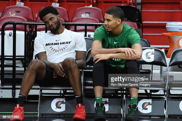 Justise Winslow of the Miami Heat and Jayson Tatum of the Boston Celtics talk before a NBA game on November 22 2017 at AmericanAirlines Arena in...