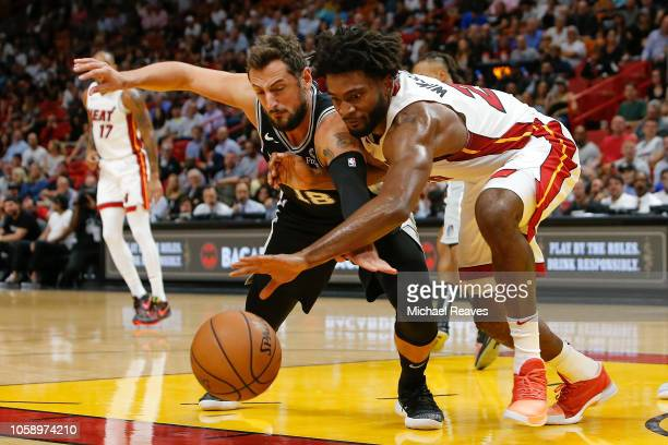 Justise Winslow of the Miami Heat and Marco Belinelli of the San Antonio Spurs battle for a loose ball during the first half at American Airlines...