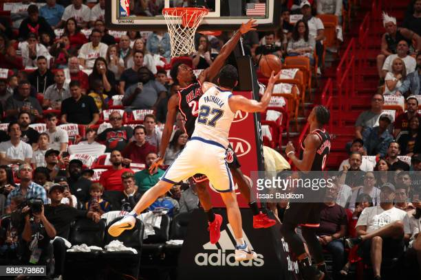 Justise Winslow of the Miami Heat blocks as Zaza Pachulia of the Golden State Warriors drives to the basket on December 3 2017 in Miami Florida NOTE...