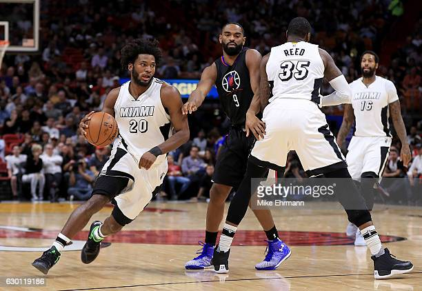 Justise Winslow of the Miami Heat drives around Wesley Johnson of the LA Clippers during a game at American Airlines Arena on December 16 2016 in...