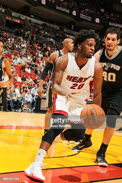Justise Winslow of the Miami Heat drives to the basket against Boban Marjanovic of the San Antonio Spurs during a preseason game on October 12 2015...