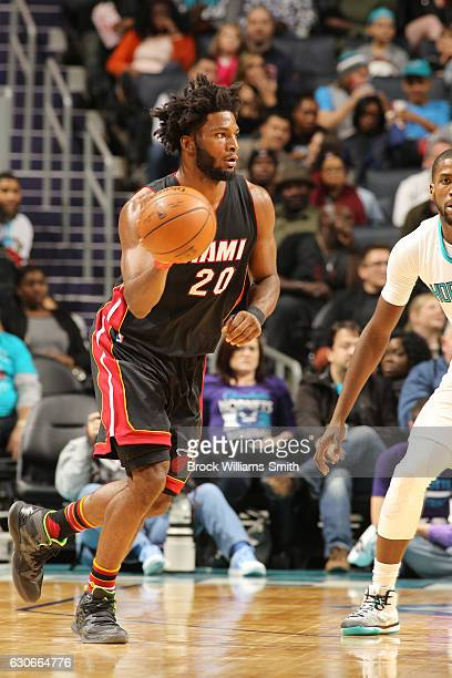 Justise Winslow of the Miami Heat drives to the basket against the Charlotte Hornets during the game on December 29 2016 at Spectrum Center in...
