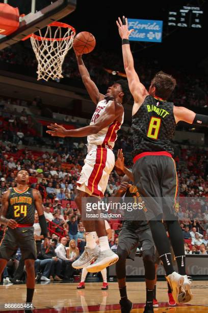 Justise Winslow of the Miami Heat drives to the basket against the Atlanta Hawks on October 23 2017 at American Airlines Arena in Miami Florida NOTE...