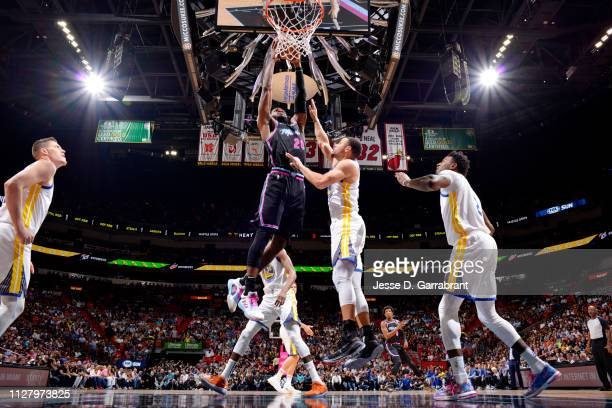 Justise Winslow of the Miami Heat dunks the ball against the Golden State Warriors on February 27 2019 at American Airlines Arena in Miami Florida...