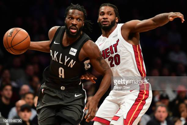 Justise Winslow of the Miami Heat guards DeMarre Carroll of the Brooklyn Nets during the game at Barclays Center on November 14 2018 in the Brooklyn...