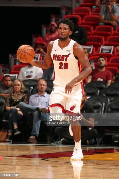 Justise Winslow of the Miami Heat handles the ball during a preseason game against the Washington Wizards at the American Airlines Arena on October...