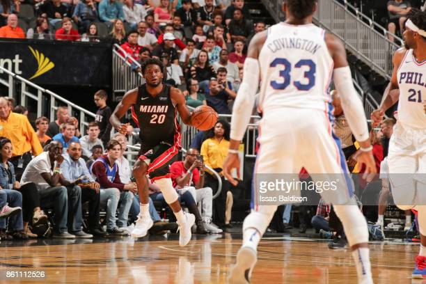 Justise Winslow of the Miami Heat handles the ball during the preseason game against the Philadelphia 76ers on October 13 2017 at Sprint Center in...
