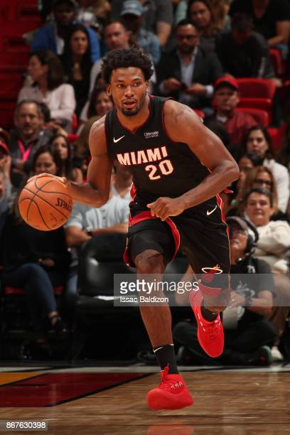 Justise Winslow of the Miami Heat handles the ball during the game against the Boston Celtics at the American Airlines Arena on October 28 2017 in...