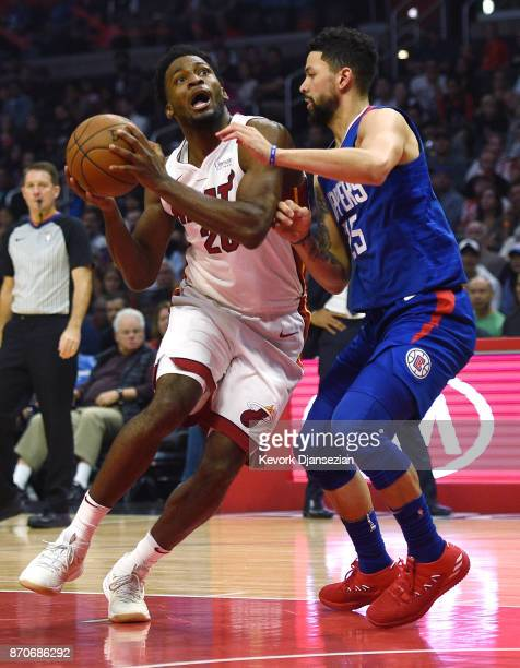 Justise Winslow of the Miami Heat in action against Austin Rivers of the Los Angeles Clippers during the first half of the basketball game at Staples...