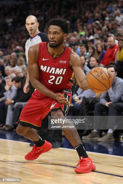 Justise Winslow of the Miami Heat moves to pass the ball against the Minnesota Timberwolves on November 24 2017 at Target Center in Minneapolis...