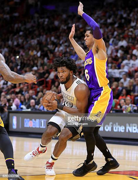 Justise Winslow of the Miami Heat posts up Jordan Clarkson of the Los Angeles Lakers during a game at American Airlines Arena on December 22 2016 in...