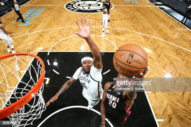 Justise Winslow of the Miami Heat shoots a lay up against Trevor Booker of the Brooklyn Nets during a preseason game on October 5 2017 at Barclays...