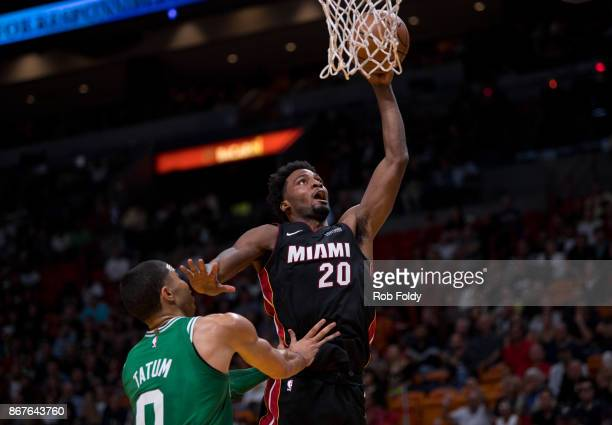 Justise Winslow of the Miami Heat shoots over Jayson Tatum of the Boston Celtics during the game at the American Airlines Arena on October 28 2017 in...