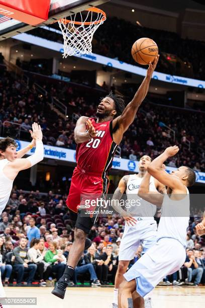 Justise Winslow of the Miami Heat shoots over Rodney Hood of the Cleveland Cavaliers during the first half at Quicken Loans Arena on January 2 2019...