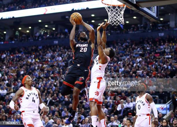 Justise Winslow of the Miami Heat shoots the ball as Kyle Lowry of the Toronto Raptors defends during the first half of an NBA game at Scotiabank...