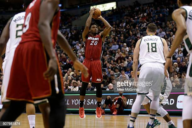 Justise Winslow of the Miami Heat shoots three pointer during the game against the Milwaukee Bucks at BMO Harris Bradley Center on January 29 2016 in...
