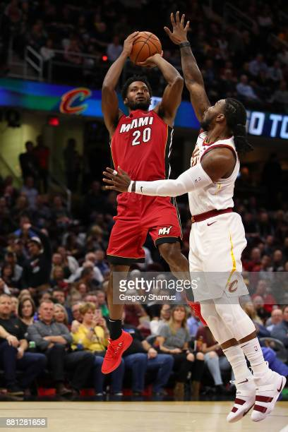 Justise Winslow of the Miami Heat takes a shot over Jae Crowder of the Cleveland Cavaliers during the first half at Quicken Loans Arena on November...