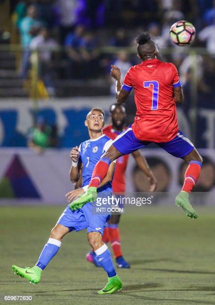 Justo Llorente fights for the ball with Donald Guerrier of the Haiti National Football Team during the second match to define the last qualified to...