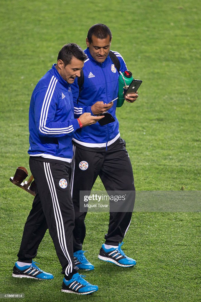 Justo Villar goalkeeper of Paraguay talks with teammate Paulo Da Silva during a training session at Alcaldesa Ester Roa Rebolledo Municipal Stadium on June 26 2015 in Concepcion, Chile. Paraguay will face Brazil as part of 2015 Copa America Chile quarter final on June 27.