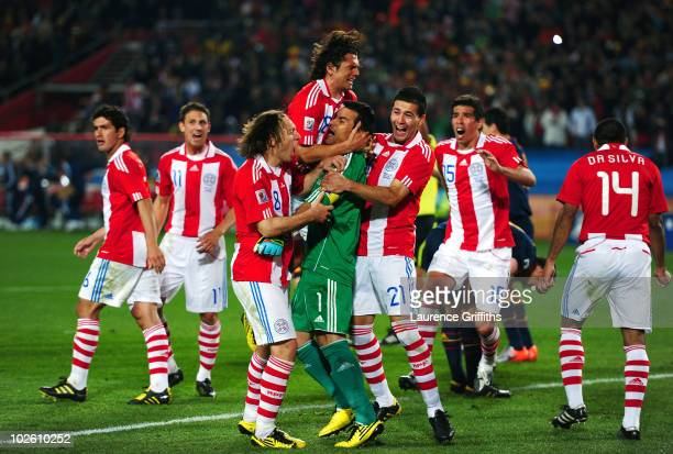 Justo Villar of Paraguay celebrates with team mates after he saves the second penalty kick from Xabi Alonso of Spain during the 2010 FIFA World Cup...