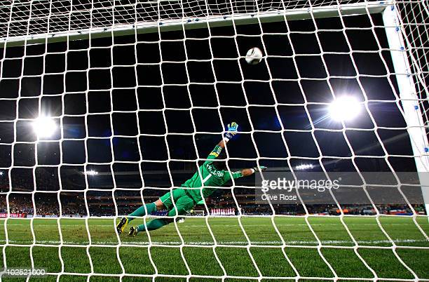 Justo Villar of Paraguay dives as Yuichi Komano of Japan misses his penalty in a penalty shootout during the 2010 FIFA World Cup South Africa Round...
