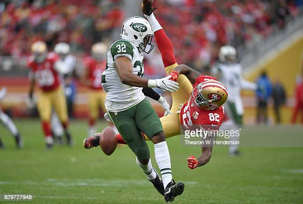 Juston Burris of the New York Jets breaks up the pass intended for Torrey Smith of the San Francisco 49ers during the third quarter of their NFL...