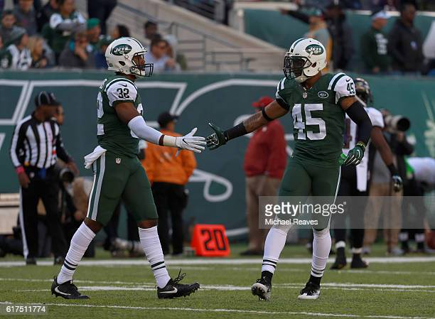 Juston Burris of the New York Jets celebrates with teammate Rontez Miles in the fourth quarter against the Baltimore Ravens at MetLife Stadium on...