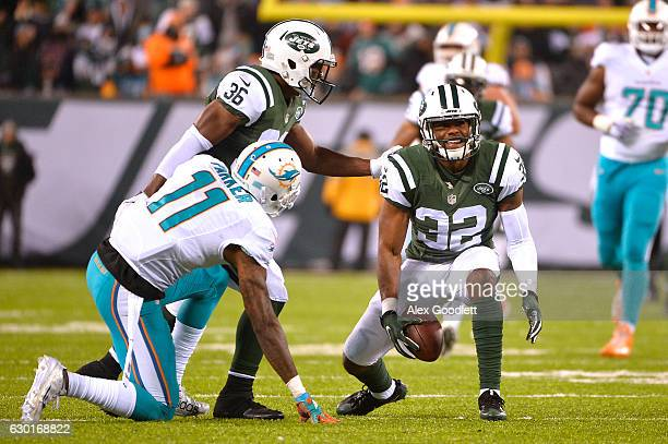 Juston Burris of the New York Jets reacts after a play against DeVante Parker of the Miami Dolphins during the third quarter of the game at MetLife...