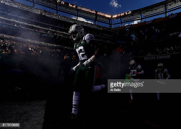 Juston Burris of the New York Jets runs onto the field before the game against the Baltimore Ravens at MetLife Stadium on October 23 2016 in East...