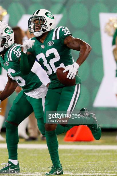 Juston Burris of the New York Jets runs with the ball after recovering it in an NFL football game against the Buffalo Bills on November 2 2017 at...