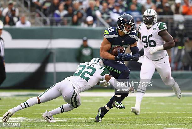 Juston Burris of the New York Jets tackles Jimmy Graham of the Seattle Seahawks in the fourth quarter at MetLife Stadium on October 2 2016 in East...