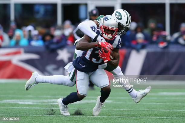 Juston Burris of the New York Jets tackles Phillip Dorsett of the New England Patriots during the second half at Gillette Stadium on December 31 2017...