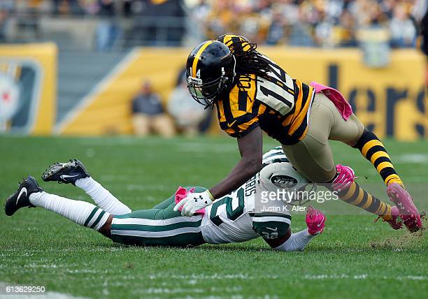 Juston Burris of the New York Jets tackles Sammie Coates of the Pittsburgh Steelers in the fourth quarter during the game on October 9 2016 at Heinz...