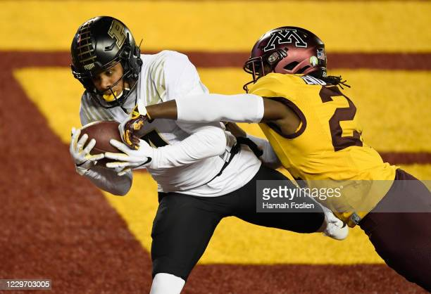 Justus Harris of the Minnesota Golden Gophers breaks up a touchdown pass intended for Rondale Moore of the Purdue Boilermakers during the second...